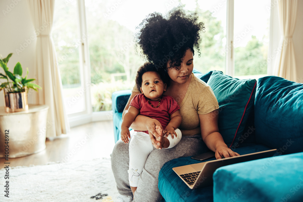 Fototapeta Freelancer working at home during maternity leave