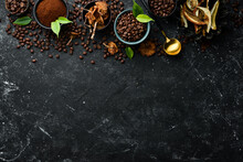Fragrant Coffee Beans And Dried Mushrooms On A Black Stone Background. Organic Food, Superfood. Top View. Free Space For Text.