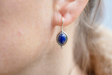 Female Ear Wearing Sterling Silver Lapis Lazuli Mineral Stone Earring