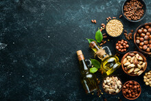 Cold Pressed Nut Oil. Assortment Of Nuts. Free Space For Your Text. Top View.