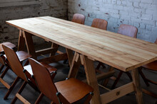 Long Empty Wooden Table And Chairs For Meeting Up In Room