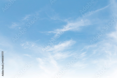 Obraz Summer Blue Sky and white clouds background. Beautiful clear cloudy in sunlight spring season. vivid cyan cloudscape in nature environment. Outdoor horizon skyline with spring sunshine.  - fototapety do salonu