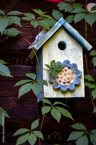 Photo Old decorative colorful wooden bird house