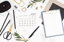 Desktop With Calendar For January And Office Supplies. Home Office, Social Media Blog, Schedule, Planning Concept. Flat Lay, Top View