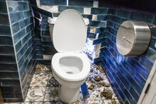 Dirty Bathroom With Broken Toilet