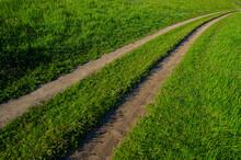 Dry Dirt Road And Green Grass On A Hillside, Rural Landscape. Web Banner.