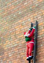 Inflatable Santa Claus Climbing A Ladder