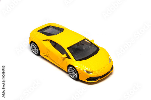 фотография A super yellow car isolated on a white background