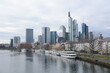 View on Frankfurts Skyline, seen from a bridge over the river Main