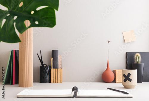 Fototapeta Grey workspace and supplies.  obraz