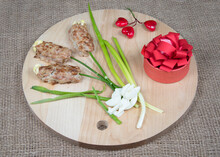 Flowers Made Of Meat On Wooden Cutting Board, Red Hearts And Natural Burlap Background. Food Art Idea For Valentine Day, Birthday, Mother's Day.