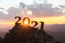 Silhouette Of Year 2021 With Sunrise On Mountain For New Year Success, Starting Of New Year Concept.