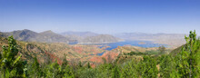 Stunning Panoramic View Of Nurek Dam Lake On The Vakhsh River, Second Highest In World Between Dushanbe And Khatlon Regions In Tajikistan With Trees Foreground