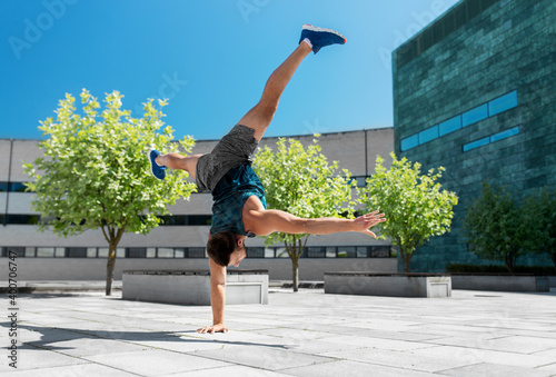 Fototapeta fitness, sport, training and lifestyle concept - young man exercising and doing