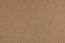 Wet Sand Surface On The Beach