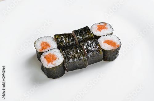 Fototapeta Asian cuisine. Sushi maki on a white plate. Top view. On a white background. obraz