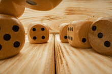 Wooden Dice Tossed On Wooden Background Close Up