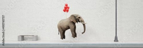 Valokuva Rote Luftballons heben einen schweren Elefanten