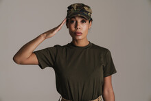 Confident African American Soldier Woman Saluting And Looking At Camera