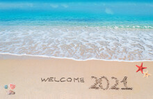 Welcome 2021 Written On The Beach
