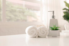 Soap Dispenser And Spa Towel ,Roll Up Of White Towels On White Table With Copy Space,towels Studio Shot On White Table