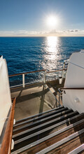 Sunset View From The Stairs Outside On A Sailing Cruise Ship.