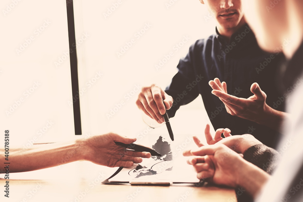 Fototapeta close up. a group of employees working on a new commercial project. Elements of this image furnished by NASA