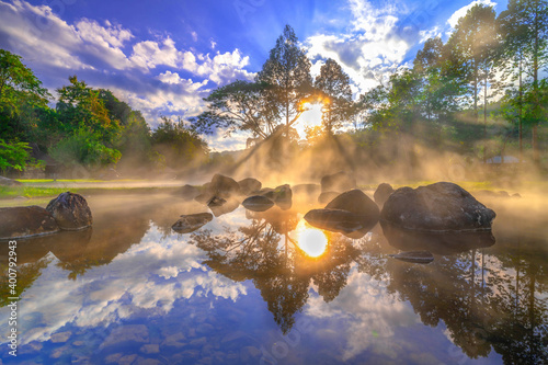 Hot springs and fog  with sunlight the morning at Chae Son National Park Mueang Pan district, Lampang province Thailand.
