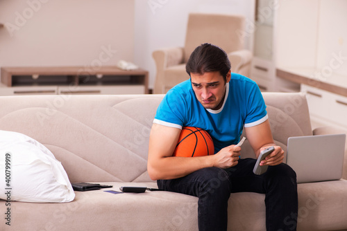 Fototapeta Sport bet addicted young man betting at home
