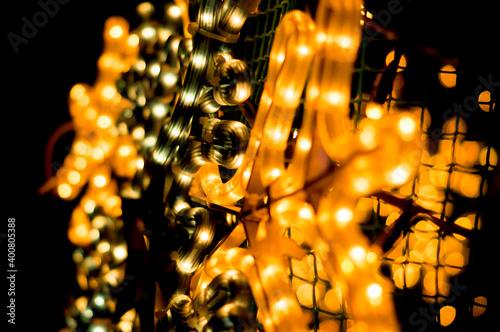 Fototapeta Christmas garland of yellow color close-up in the dark obraz na płótnie
