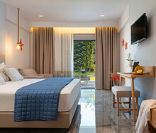 Side View Of Modern Interior Blue And White Bedroom Hotel Apartment With Open Window To Summer Garden View Terrace
