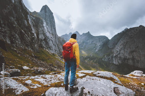 Obraz Man backpacker enjoying mountains landscape travel hike alone in Norway outdoor adventure active healthy lifestyle weekend leisure tour - fototapety do salonu
