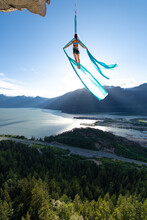 Woman On Aerial Silks On The Stawamus Chief In Squamish, British Columbia, Canada