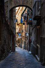 Italy, Campania, Naples, Narrow Alley Along Old City Houses