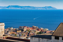 Italy, Campania, Naples, Coastal City With Blue Waters Of Gulf Of Naples In Background