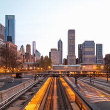 Illuminated Railway Tracks Against Buildings In City Chicago, USA