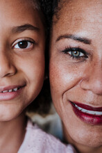 Close-up Of Smiling Mother And Daughter At Home