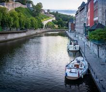 Belgium, Namur Province, Namur, Motorboats Moored Along City Canal