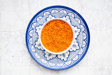 Bowl Of Fresh Red Lentils On Blue Plate
