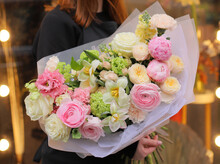 Flower Shop. Beautiful Bouquet Of Mixed Flowers In Bright Pink Color In Woman's Hands. Work Of The Florist At A Flower Shop.  Fresh Cut Flower.