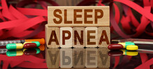 On The Surface Are Visible Tablets, A Syringe, Wooden Dies And Their Reflections On Which It Is Written - SLEEP APNEA