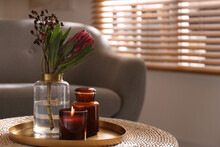 Vase With Beautiful Protea Flower And Candles On Wicker Stand Indoors, Space For Text. Interior Elements