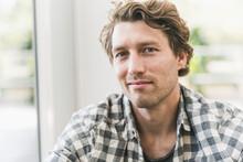 Smiling Man Sitting At Home