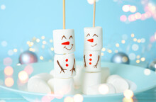 Funny Snowmen Made Of Marshmallows In Plate, Closeup. Bokeh Effect
