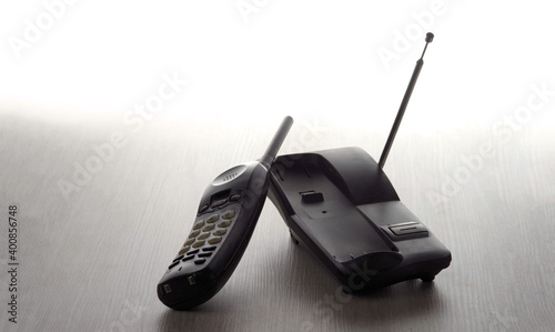 Tela Wireless cordless telephone off the hook on a light wooden background