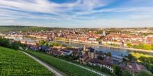 Germany, Bavaria, Wurzburg, Panorama Of Vineyard And Houses Of Riverside CityÔøΩat Dusk