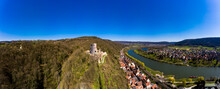 Germany, Bavaria, Stadtprozelten, Helicopter View Of Riverside Town In Autumn With Henneburg Castle In Background
