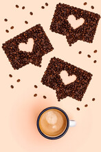 Studio Shot Of Mug Of Coffee And Roasted Coffee Beans Arranged Into Shapes Of Online Chat Bubbles