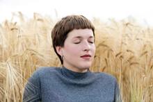 Woman Dreaming Against Grain Field