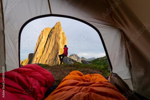 Female explorer camping on mountain at Segla, Senja, Norway